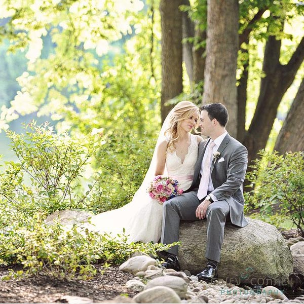 Wedding couple sitting on rock